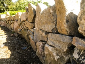 Socially engaged art - stone wall base for the cob wall
