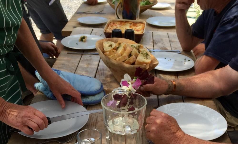 LandWorks trainees enjoy a lasagne lunch