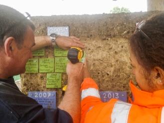 Participants placing handmade tiles on timeline