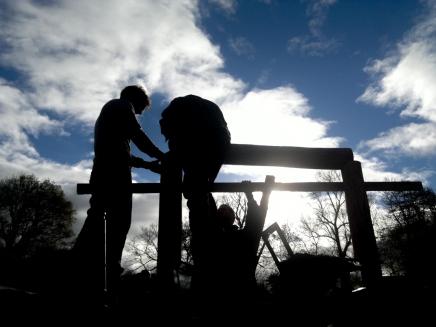 Participants raising the roof on a new land art sculpture