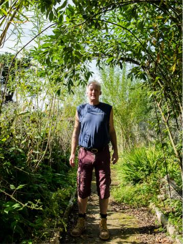 Chris Parsons in LandWorks' Garden. Photo Credit: Recourse Magazine